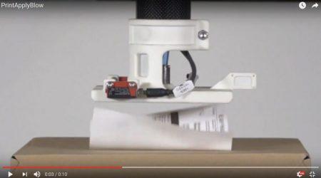 A tamp-blow label applicator