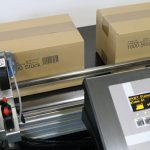 Markoprint inkjet printer printing on cardboard boxes