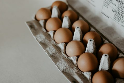 A label printer over a pack of eggs